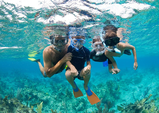 Chrystal and her husband very happy to start a snorkeling tour with her son.