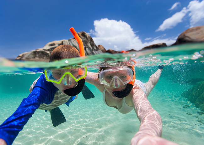 Michelle and her brother enjoying a snorkeling time in El Cielo.