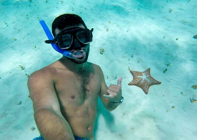 Paul amazed by a starfish he found snorkeling in El Cielo Cozumel.